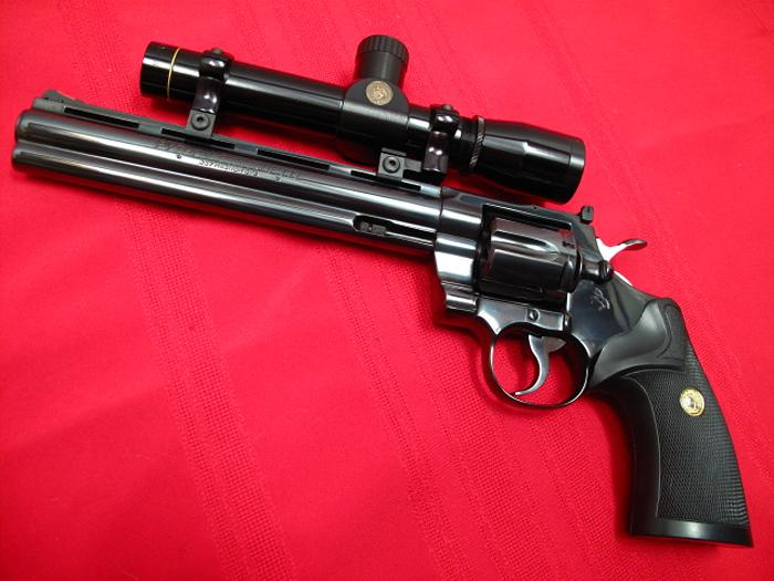 HD Quality Wallpaper | Collection: Weapons, 700x525 Colt Python Silhouette Revolver